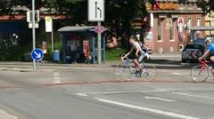 4K Pedestrian Commuter Bicycle Biker crosswalk zebra cross Munich Germany Europe Stock Footage