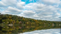 Forest and moving clouds. Autumn lake. Stock Footage