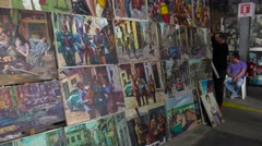 Artists display their paintings in a tourist gallery in Havana, Cuba. Stock Footage