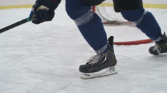 Low Section of Ice Hockey Players Dribbling Stock Footage