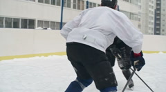 Ice Hockey Player Jumping over Defense Stock Footage
