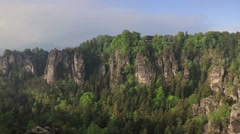 Misty morning on sandstone cliff in Saxony Switzerland. Colorful spring scene Stock Footage