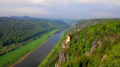 Foggy spring view of Rathen village from viewpoint of Bastei in Saxon Switzer Stock Footage