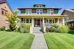 Nice curb appeal of American craftsman style house. Column porch view and wel Stock Photos