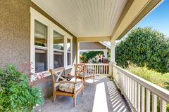 Front covered porch with outdoor furniture overlooking neighborhood. Northwes Stock Photos