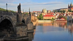 Colorful morning view with Charles Bridge and Prague Castle and St. Vitus cat Stock Footage