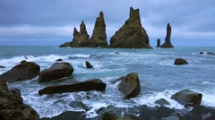 White nights view of Reynisdrangar cliffs in the Atlantic ocean. South Icelan Stock Footage