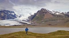Walking on the shore of laguna near Vatnajokull glacier Stock Footage