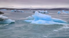 Melting of blue icebergs in Jokulsarlon glacial lagoon Stock Footage
