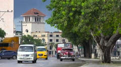 Classic old cars travel on the streets of Havana, Cuba. Stock Footage