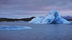 Floating of blue icebergs in Jokulsarlon glacial lagoon Stock Footage