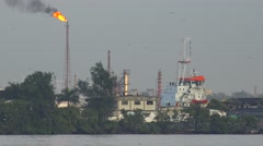 Harbor ferry boats pass in Havana harbor, Cuba, with an industrial scene as a Stock Footage