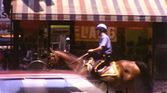 Cop on Horse Street Patrol Police Ride NYC 1970s Vintage Film Home Movie 9998 Stock Footage