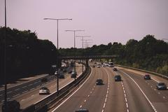 BEACONSFIELD, ENGLAND - JUNE 2016: Busy M40 motorway at the Beaconsfield turn Stock Photos