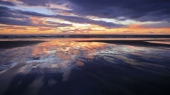 Time lapse clip. Moving sunset clouds on the north coast of Iceland's Snafell Stock Footage