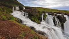 White nights view of Kirkjufellsfoss Waterfall and Kirkjufell mountain. Snaef Stock Footage