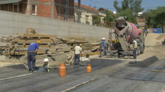Concreting and water insulation at building construction site by Sheyno. Stock Footage