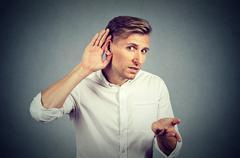 Hard of hearing man asking someone to speak up Stock Photos