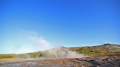 Erupting of the Great Geysir lies in the Haukadalur valley on the slopes of L Stock Footage