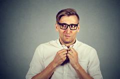 Nervous stressed man feels awkward anxiously craving something Stock Photos