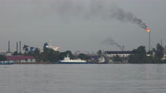 Ferry boats pass in the harbor in havana, Cub with an industrial scene Stock Footage