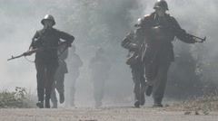 Soldiers run with gas masks through a heavy smoke Stock Footage