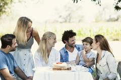 Family and friends spending time together outdoors Stock Photos