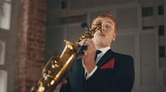 Saxophonist in dinner jacket play on golden saxophone. Jazz artist. Performance Stock Footage