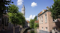 Traffic passing by a church along a canal in Amersfoort (NL), 4K time lapse Stock Footage