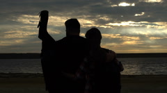 Couple silhouette with guitar standing and hugging  Stock Footage
