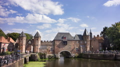 People passing an spectacular medieval city gate, the Netherlands, 4K time lapse Stock Footage