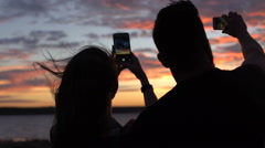 Couple taking photos with smartphones Stock Footage