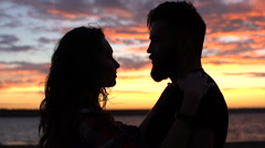 Couple silhouette standing and hugging on the sunset  Stock Footage