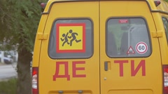 Minibus with the inscription children slow motion video Stock Footage