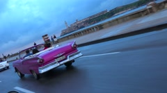 Classic old cars and horse carts are driven through the colorful streets of Stock Footage