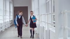 Little Schoolboy and Schoolgirl in Love Stock Footage