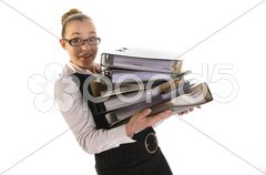 Frau mit Akten im Arm lächelt in die Kamera Stock Photos