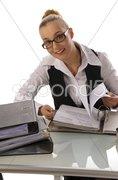 Steuerberaterin blättert in Akten, lacht Stock Photos