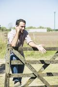 Wireless technology ensures easy communication for farmers working fields Stock Photos