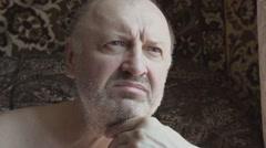 A single pensioner looks sad look Slow Motion Stock Footage