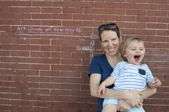 Mother and toddler son together outdoors, portrait Stock Photos