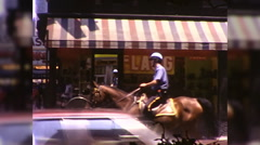 Cop on Horse Street Patrol Police Ride NYC 1970s Vintage Film Home Movie 9952 Stock Footage