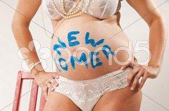 Junge Schwangere mit Babybauch 'Newcomer' Stock Photos