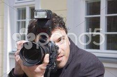 Mann mit Digitalkamera Stock Photos