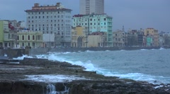 Waves break on the Malecon in Havana Cuba during a winter storm. Stock Footage