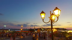 Tourists and traffic in old town of Nesebar, Bulgaria at sunset Stock Footage