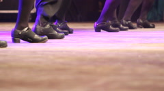 One row of people doing Irish dance with traditional step shoes Stock Footage