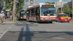 Toronto TTC Transit Buses Cyclists Bike Riding Through College Bathurst Stock Footage
