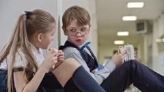 Schoolchildren Chatting on Lunch Break Stock Footage