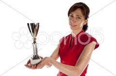 Erwachsene Frau hält Pokal in der Hand, Sportlerin Stock Photos